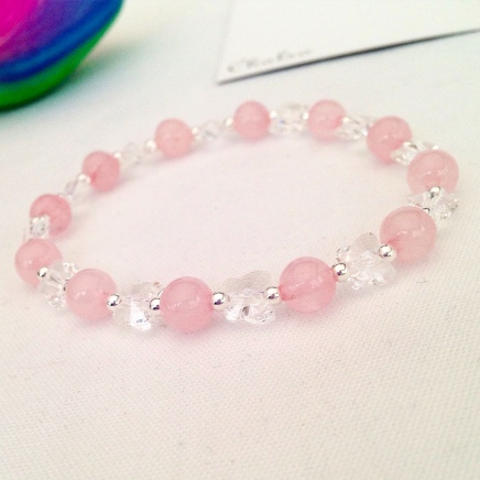 Rose Quartz bracelet with Swarovski crystal butterflies and Sterling silver.