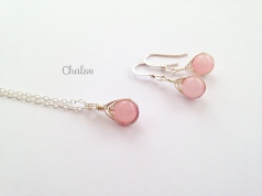 Matching pendant and earrings with Rose Quartz wrapped in Sterling silver.