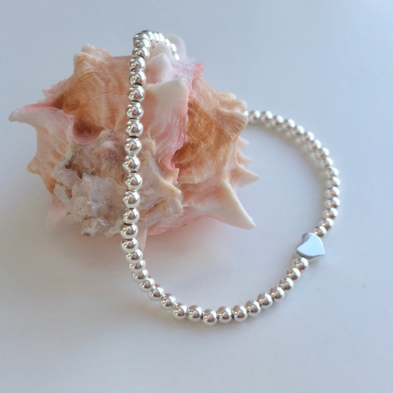 Tiny Sterling silver bead bracelet with teeny heart focal bead