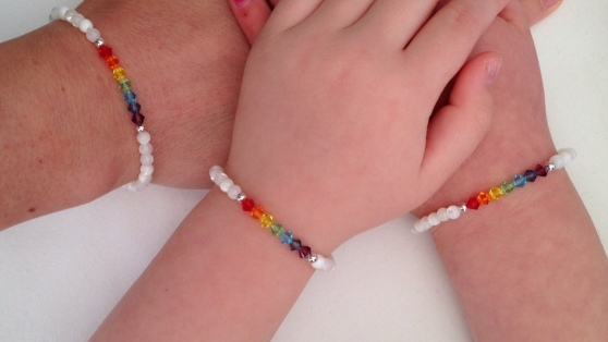 Rainbow bracelets made with Mother of Pearl, Sterling silver and Swarovski crystal elements. My girls and I love these, we have one each!