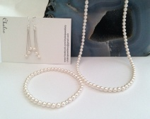 Pearl necklace, bracelet and earrings made with tiny, white Swarovski pearls and Sterling silver.