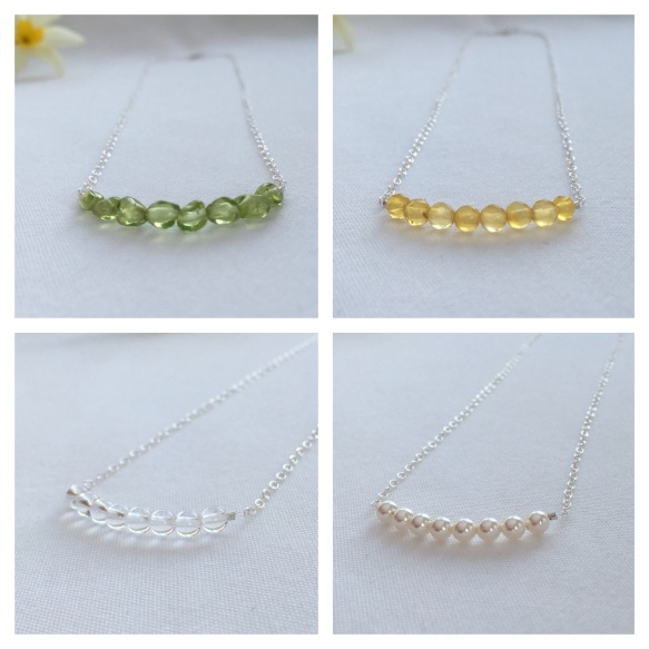 Peridot (August), Citrine (November), Crystal Quartz (April) and Pearl (June) necklaces