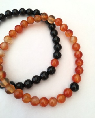 His and Hers Lava bracelets with Onyx and Carnelian to represent Earth and Fire.