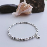 Sterling silver bracelet wth tiny heart charm