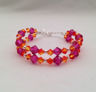 This was a custom order for a double stranded Fire Opal and Fuchsia flower girl bracelet made with Swarovski crystal elements and Sterling silver.