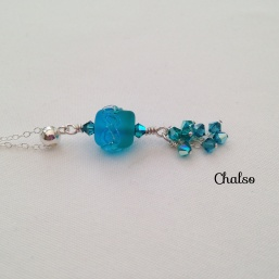 Turquoise and sea green lampwork pendant with Swarovski crystals and Sterling silver.