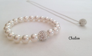 White glitter ball set with Swarovski pearls. Also available in different colours.