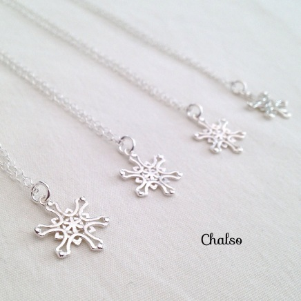 Sterling silver snowflake necklaces. Perfect for a winter wedding.