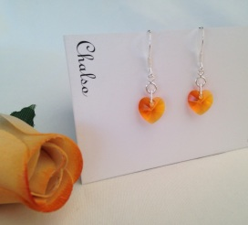 Sterling silver earrings with Tangerine Swarovski hearts.