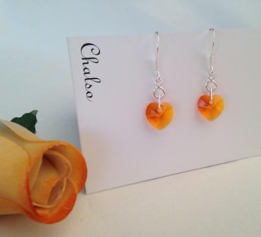 Sterling silver earrings with Tangerine Swarovski hearts.