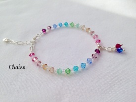 Pastel rainbow birthstone bracelet with Swarovski crystals. A perfect gift for mum, you can choose the number of birthstones. The one shown has ruby and sapphire for July and September.