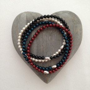 Tiny pearl bracelets, available in red, white, blue and black