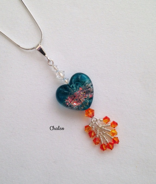 Fire and Ice pendant made with Starburst lampwork heart, Sterling silver and Swarovski crystal elements.