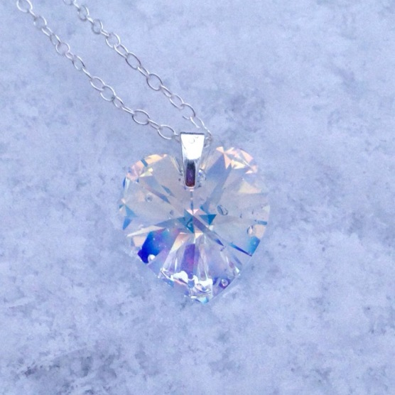 Clear crystal AB Swarovski heart necklace. The AB stands for aurora borealis and is a coating which gives the crystal a flash of colour.
