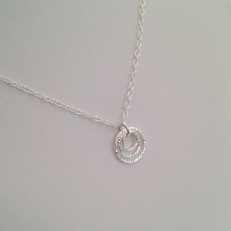 Triple Circle, Sterling silver pendant.