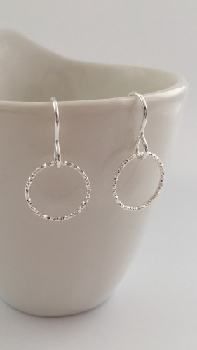 Single Circle earrings made with sparkly, diamond cut, Sterling silver rings.