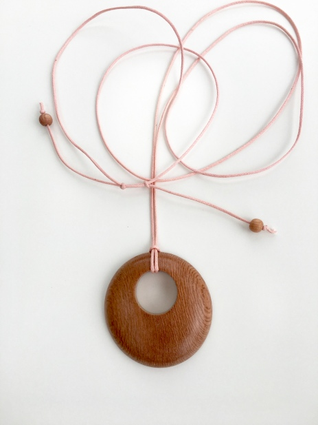Rosewood pendant with pale pink cotton cord.