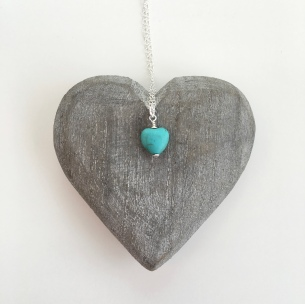 Turquoise heart pendant on Sterling silver chain. This necklace would make a lovely gift for your girlfriend, sister or daughter.
