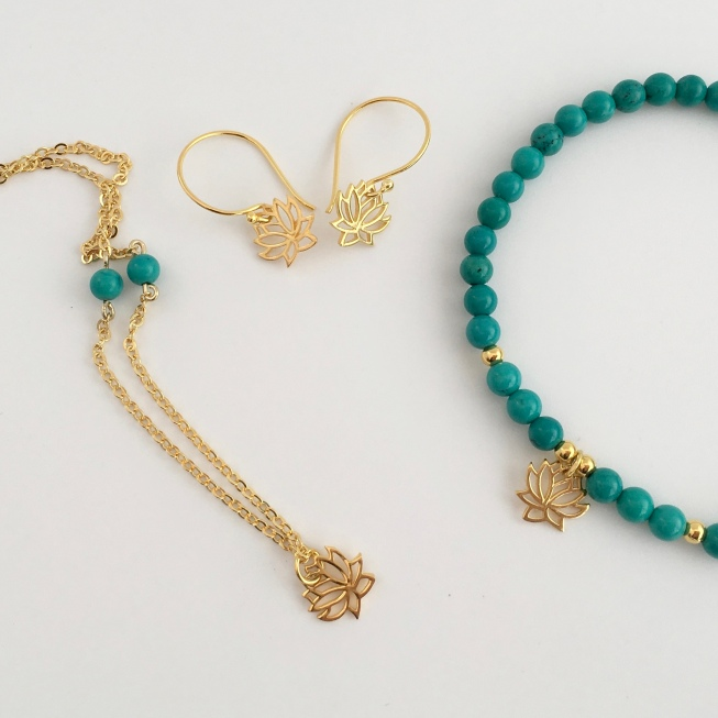 This Turquoise and Gold lotus flower bracelet, necklace and earrings set would make a great gift! Made with Turquoise semiprecious stone beads and 24K gold vermeil lotus flower charms.