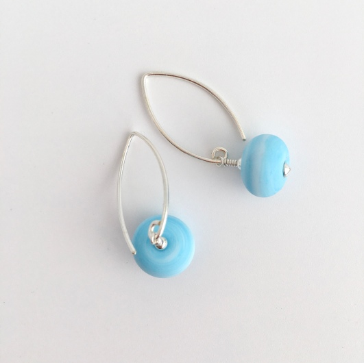 Lovely light blue Lampwork earrings with Sterling silver. These earrings would make a great addition to your spring/summer wardrobe or a gift for a friend.