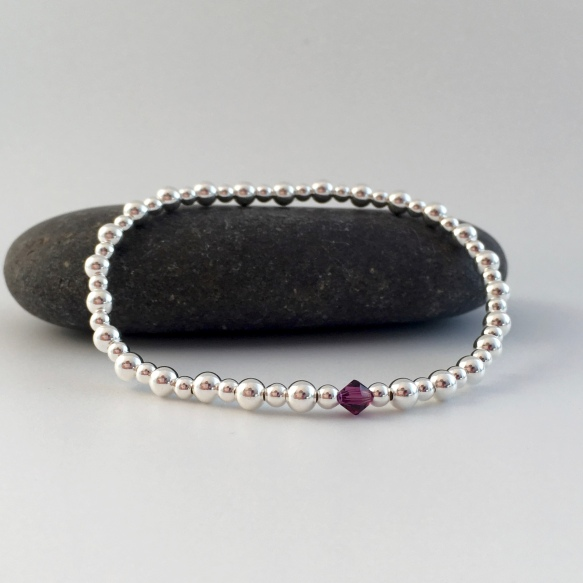 Sterling silver bead stretch bracelet with Swarovski birthstone crystal.