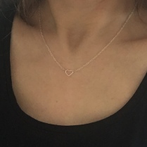 Sterling silver open heart necklace.