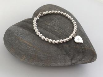 Sterling silver initial heart bracelet
