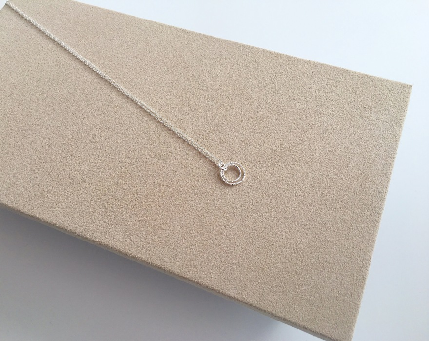 Sterling silver double circle necklace with diamond cut, sparkly, Sterling silver rings.