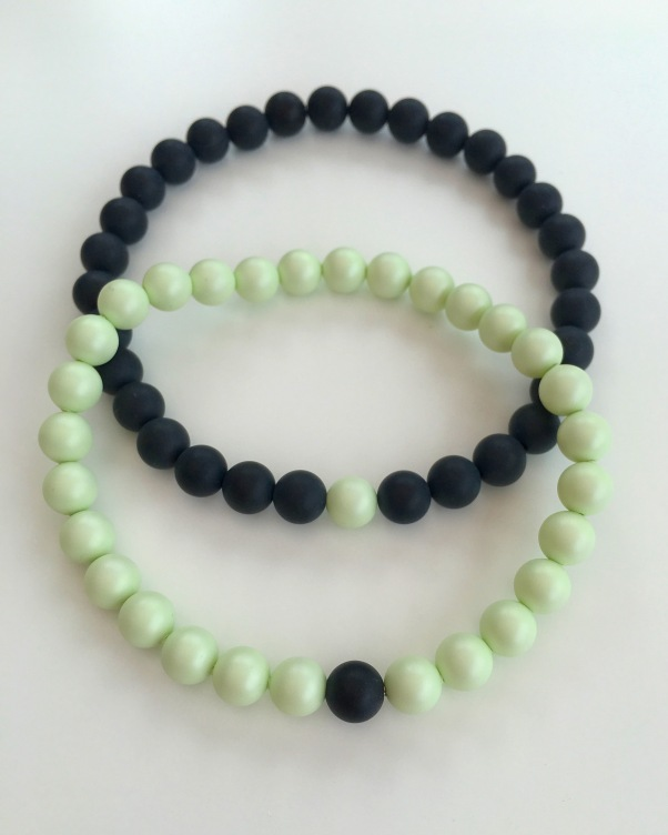 Pastel green Swarovski pearls and matte black Onyx couples bracelets.