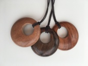 Rosewood, Tiger ebony and Bayong circular pendants on dark brown cotton cord.