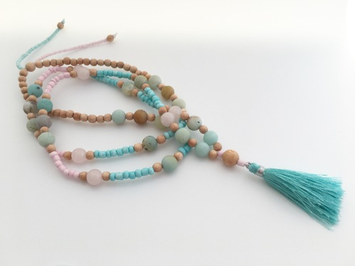 Long pastel necklace with Rosewood, Rose Quartz and frosted Amazonite with a turquoise tassel.
