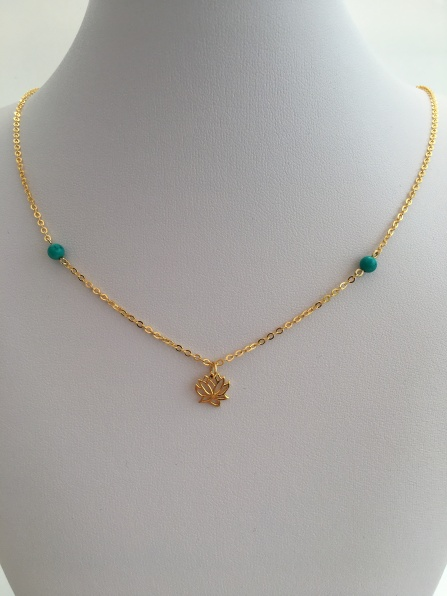 This Turquoise and Gold lotus flower necklace would make a great gift! Made with Turquoise semiprecious stone beads and a 24K gold vermeil lotus flower charm.