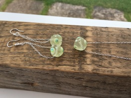 Beautiful lime green lampwork beads with white, blue and black spots on Sterling silver chain.