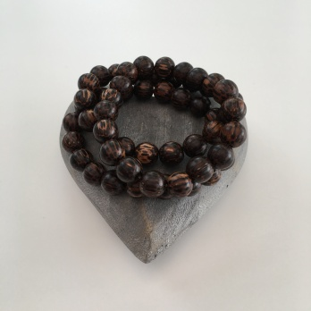 Old Palm wood bracelets. Chunky wooden, unisex, bracelet. Perfect for him or her. Made with 10mm Old Palm wood beads in delicious brown shades. Each bead is uniquely patterned with dark brown stripes and spots on a lighter brown background.