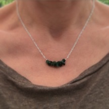 Raw Emerald necklace with Sterling silver. Emerald is May's birthstone. It is a beautiful dark green colour. This necklace is made with natural raw Emerald gemstones and Sterling silver.