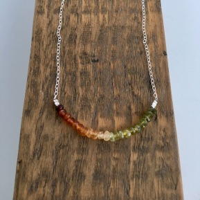 Ombré Garnet necklace made with Hessonite and Grossular faceted rondelles ranging in colour from red to green.