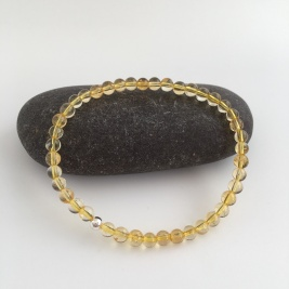 Citrine bracelet, November birthstone bracelet. This is a stretch bracelet made with 4mm Citrine semi precious stone beads with a single Sterling silver bead. The Citrine stone is a beautiful yellow colour.