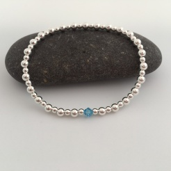 Sterling silver stretch bracelet with Aquamarine Swarovski crystal element.