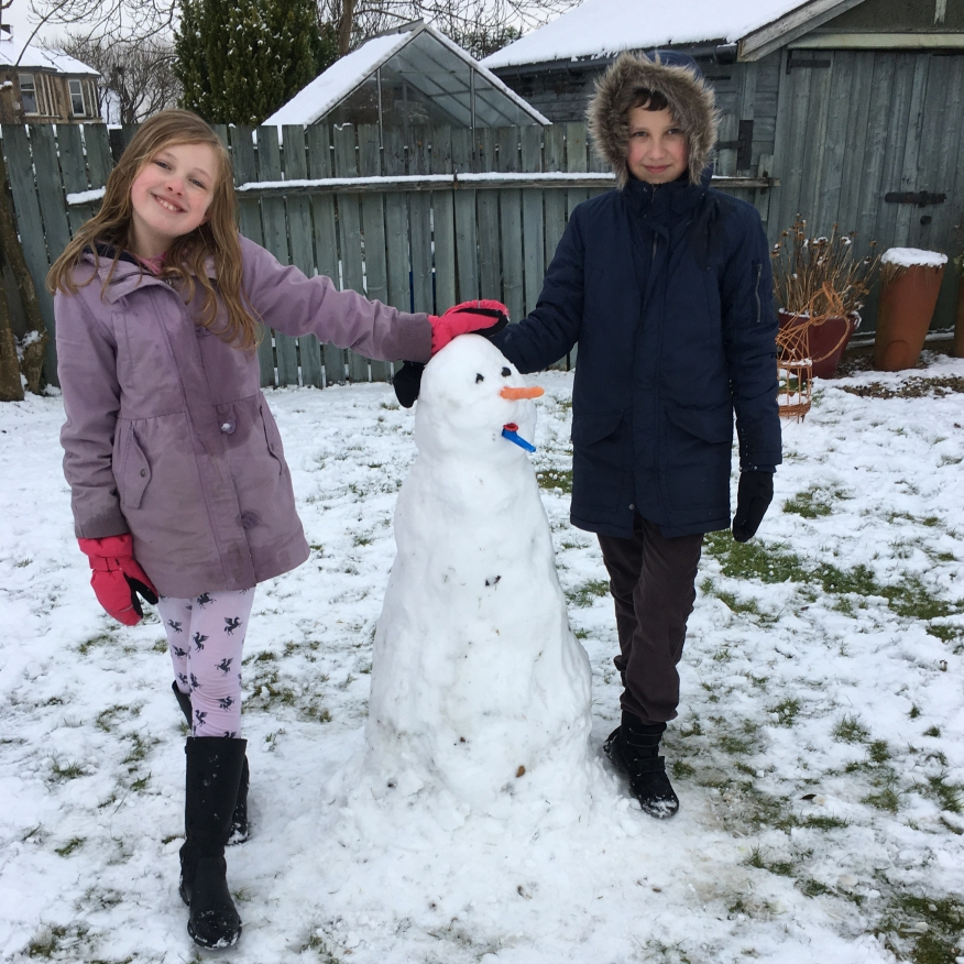 The kids were delighted to get enough snow for a snowball fight and a snowman!