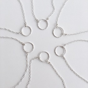 These Sterling silver circle necklaces were made for a bride to gift to her bridesmaids.
