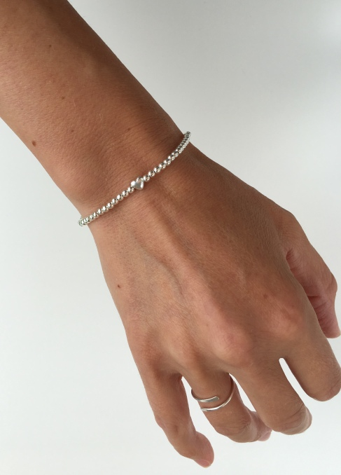 Minimalist Sterling silver heart bracelet and wraparound ring.