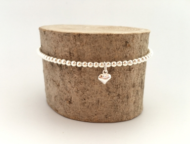 Sterling silver bracelet made with tiny silver beads and heart charm.
