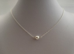Single pearl necklace with a white Swarovski pearl on Sterling silver chain.