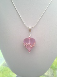 Cherry blossom heart pendant made with a lampwork glass heart, Sterlings silver and Swarovski crystal elements.