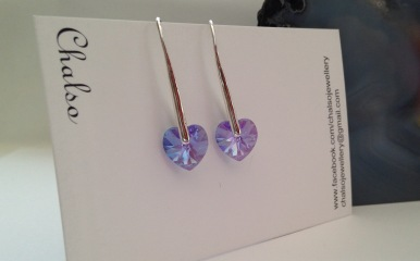 These beautiful violet heart earrings feature super sparkly, 10mm Violet AB Swarovski crystal hearts and solid Sterling silver ear hooks.