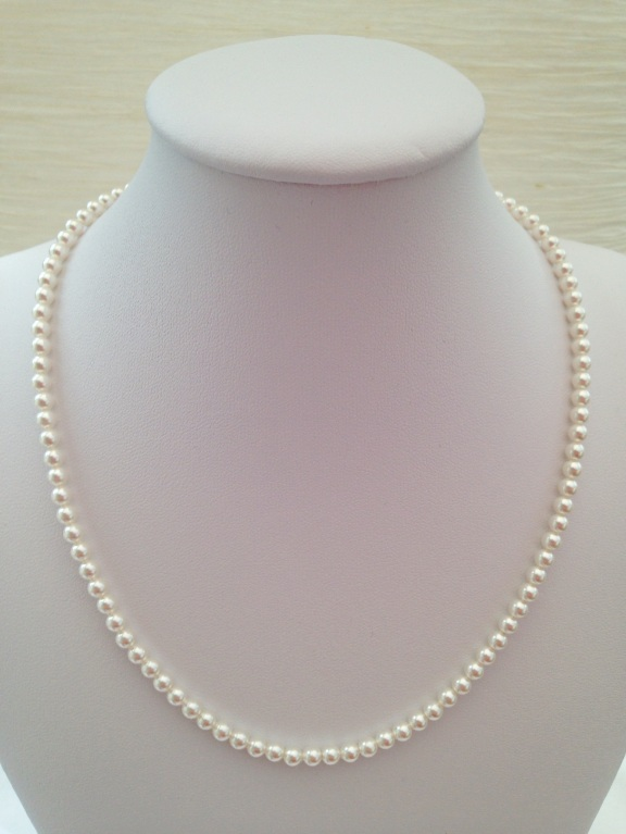 Pearl necklace made with small, white Swarovski pearls. A beautiful minimal piece. Can be purchased alone or as part of a set.