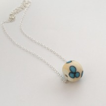 Blue flower lampwork charm bead on Sterling silver chain.