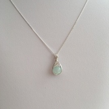 Beautiful, pale blue Aquamarine wrapped with Sterling silver, available with matching earrings.