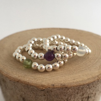 Shown with Peridot, Amethyst and Opal
