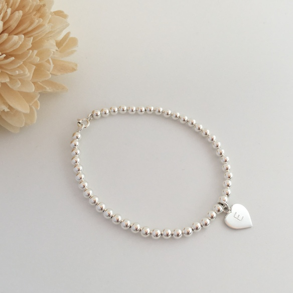 Sterling silver bracelet with personalised heart charm. Makes a great gift for your daughter or flower girls!